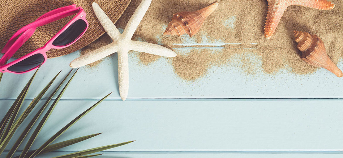 Sunglasses and starfish on the blue wooden floor,summer concept